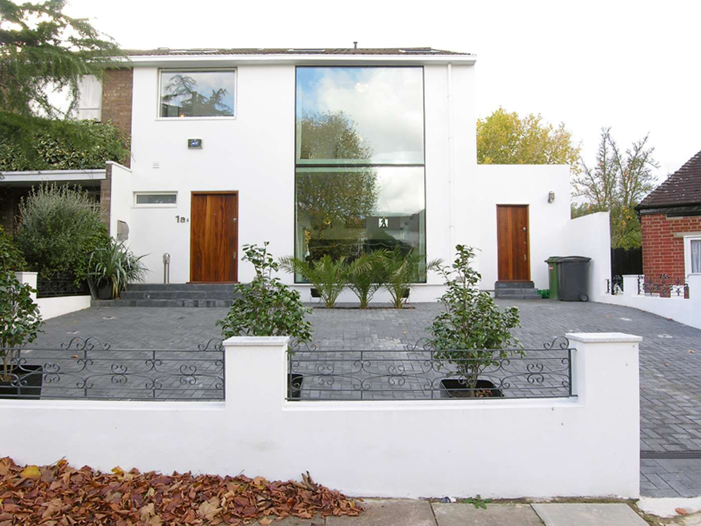 A remodelled 1960s semi homebuilding renovating for 70s house exterior makeover