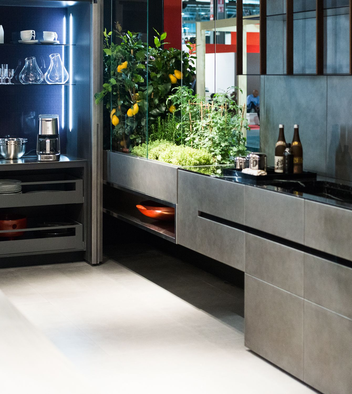 design kitchen italian%0A Modern Italian kitchen design features concealed work areas  warm grays and  always live plants