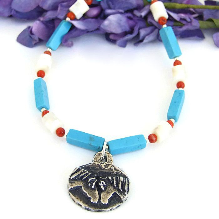"""The """"Forever Friends""""  artisan pendant necklace was handmade with a two sided horse pendant, turquoise magnesite, mother of pearl, red coral and sterling silver - southwest inspired jewelry - by Shadow Dog Designs Jewelry"""