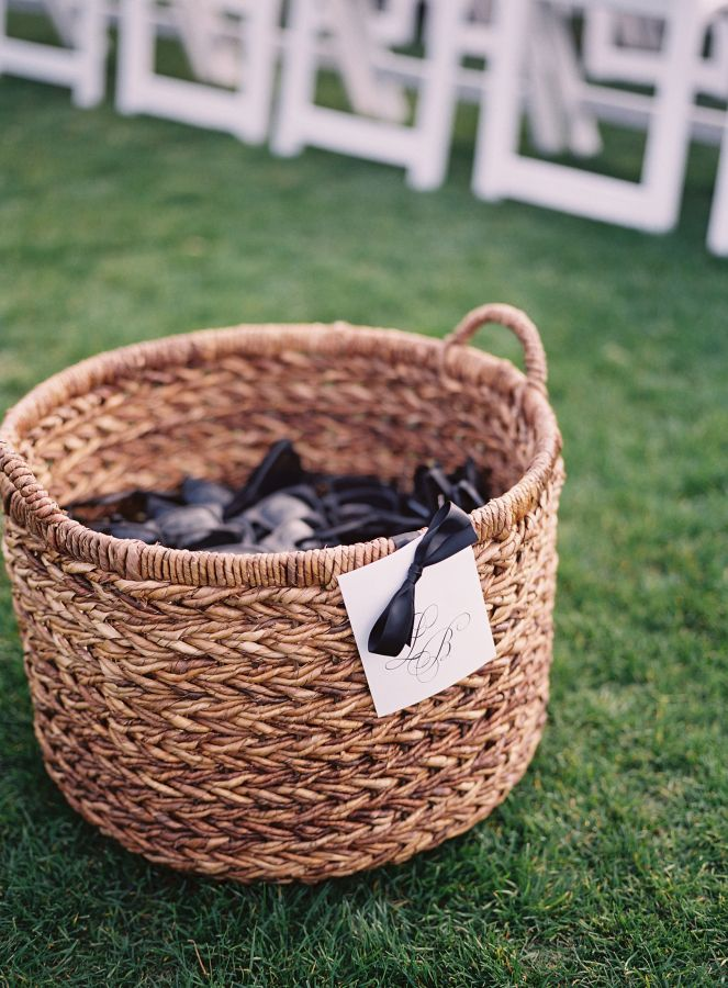 A basket of sunglasses for a summer wedding: http://www.stylemepretty.com/2016/07/08/classic-hilton-head-wedding/ | Photography: Heather Payne Photography - http://heatherpaynephotography.com/