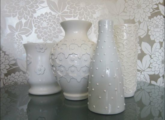 use hot glue to create sweet designs on glass and spray paint..simple!