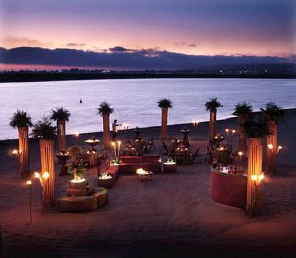 how amazing is this beach wedding lounge lite up against the sunset love the