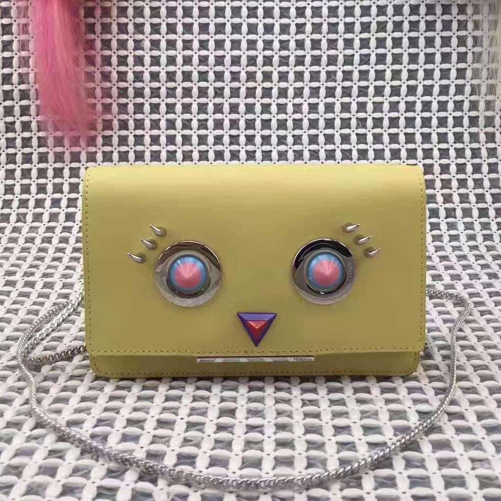 8bb3647969bd Fendi Calfskin Wallet On Chain With Metal Round Eyes Motif Yellow 2017