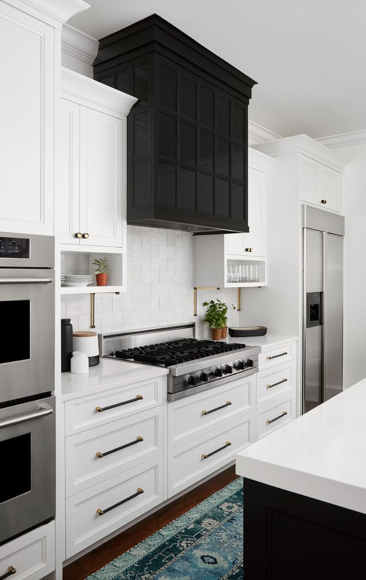 statement black kitchen hood Modern Black And