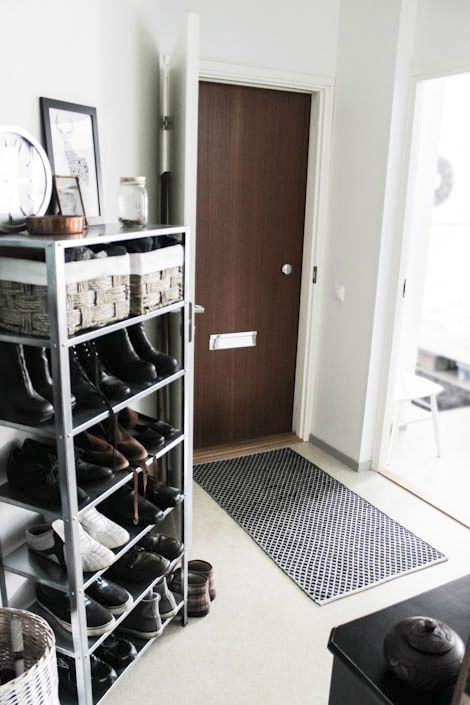 Entryway, gray and black rug, industrial style, brown, black and white colors