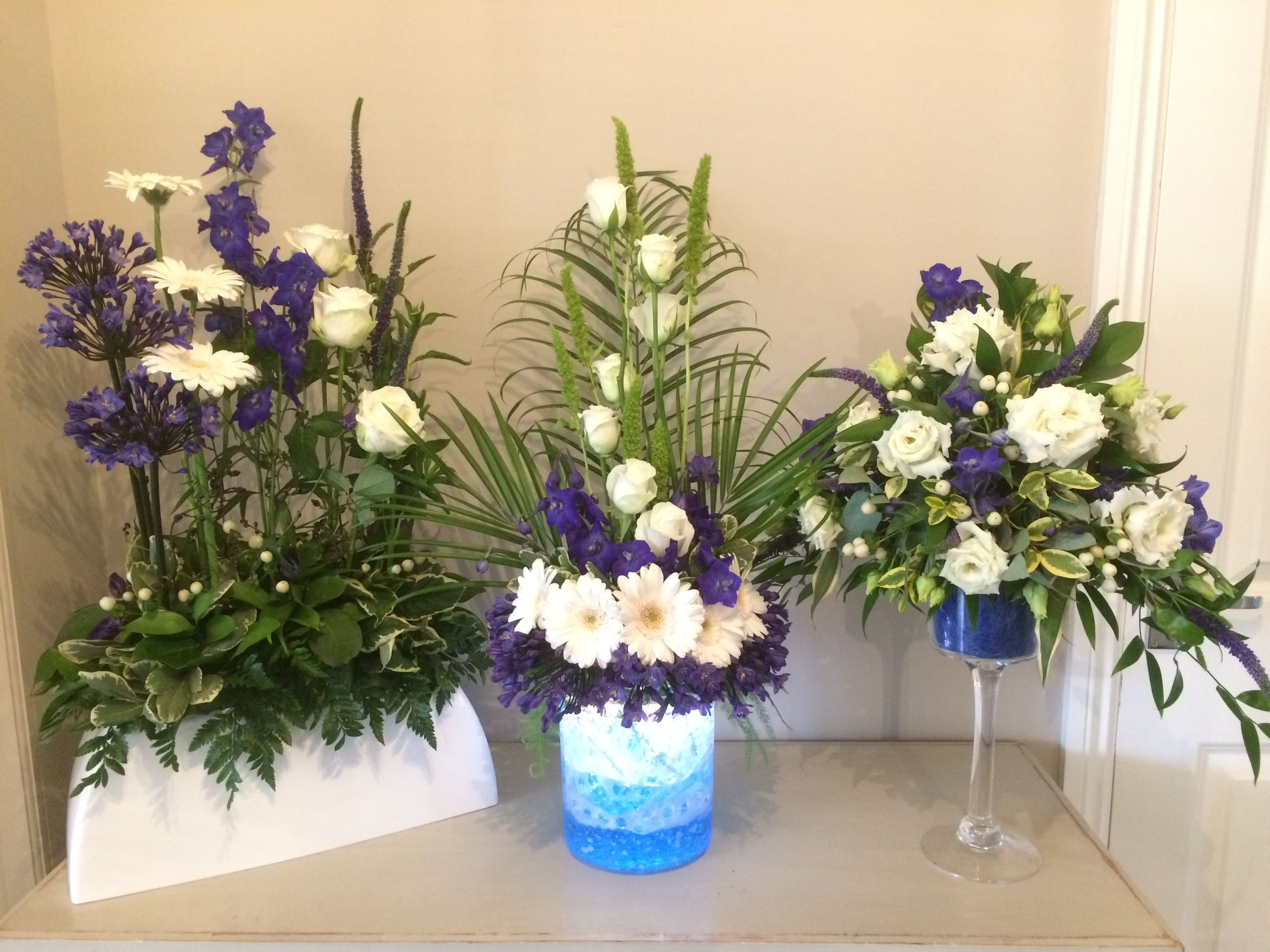 lovely collection of blue and white flower arrangements