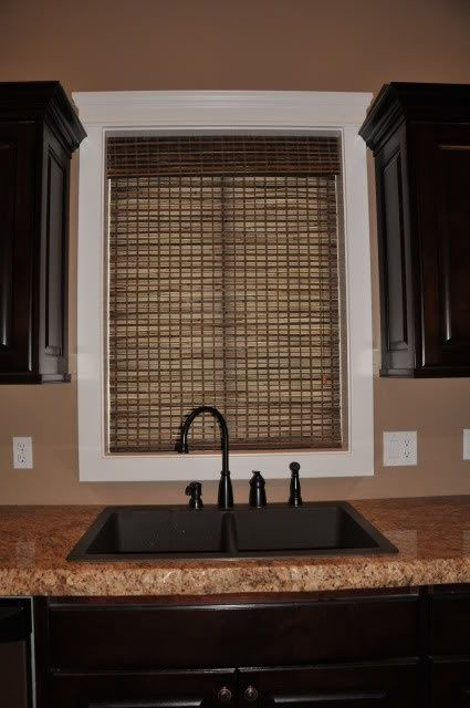 Black cabinets, brown counters. Of course, ours are much darker and not pretty granite