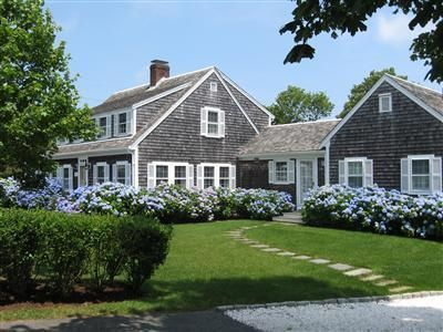 Beautiful home in Chatham, MA. This could be described as a Cape Cod or possibly Shingle Style.