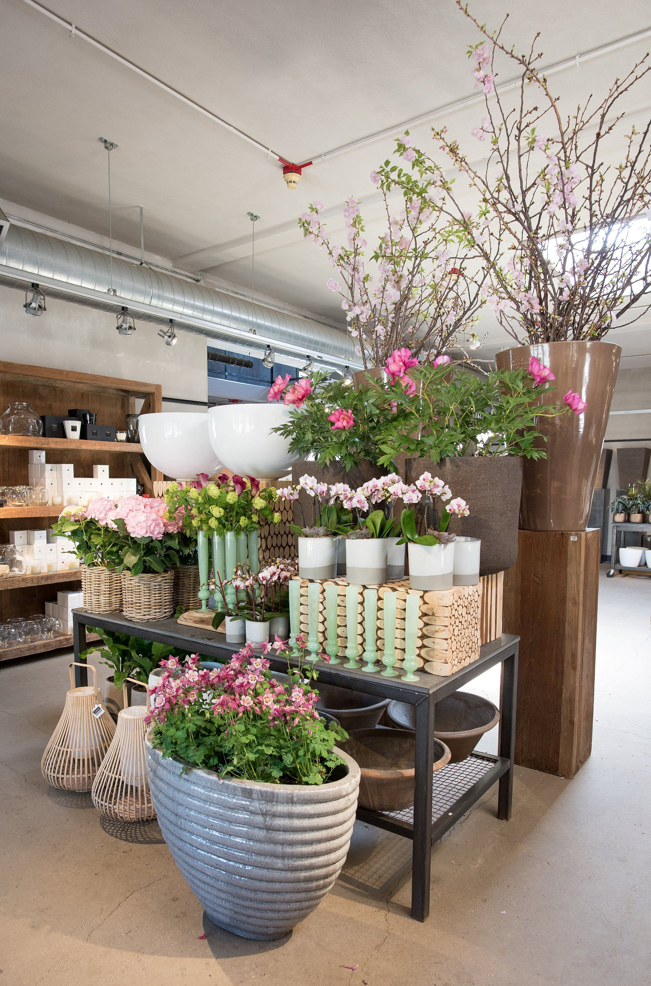 A table display with soft greens and touches of pink at a
