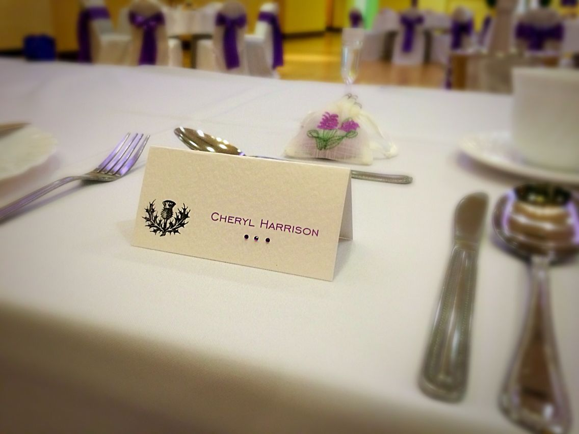 Place card with printed name thistle image and purple diamantes