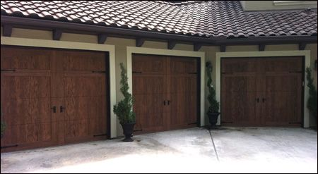Clopay Canyon Ridge Collection Stained Faux Wood Carriage House Garage Doors Design 11 With Arch1 Top Pecky Cyp House Exterior Garage Door Installation Doors