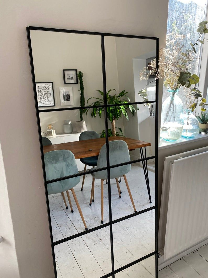 Large industrial mirror with sprouts