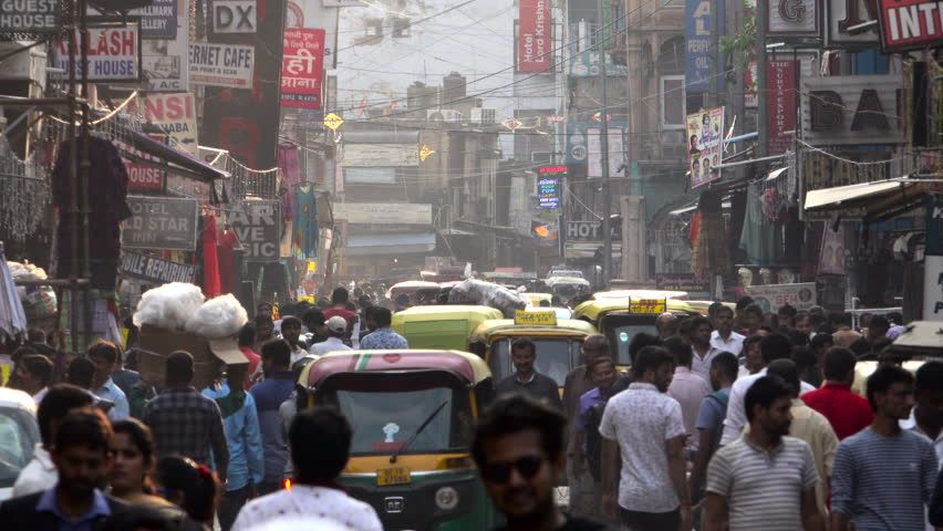 Ad: NEW DELHI, INDIA – SEP 8: Crowded street scene with pedestrians and auto ric…