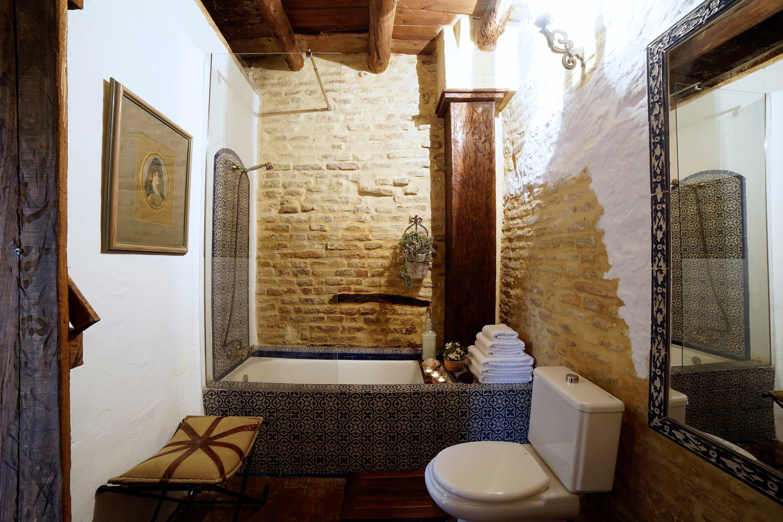 diy distressed bathroom vanity%0A Beautiful rustic bathroom with distressed stone brick walls  wood beam  ceiling  DIY handmade tile bathtub  u     shower using salvaged  recycled blue  u      white