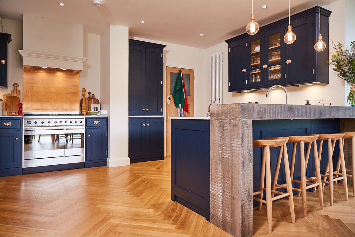 A Contemporary Redesign With Rich Dark Blue Painted Cabinets Highlighted By Polished Kitchen Decor Inspiration Kitchen Inspiration Design Copper Kitchen Decor