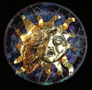 repurposed hubcap art