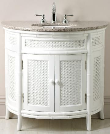 rattan weave and marble countertop on this white vanity for the rh pinterest com