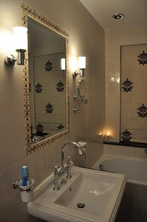 Art Deco-style bathroom lights. Swing mirror + faucet is awesome. Even like the sink.