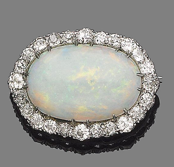 A late 19th century opal and diamond cluster brooch  The oval cabochon opal within an old brilliant-cut diamond surround, diamonds approx. 1.80cts total, width 3.2cm