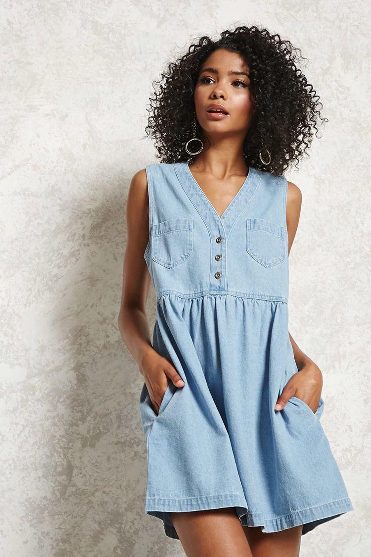 b9564a5837a26b A sleeveless denim dress featuring a front button-up placket, an A-line  silhoutte, V-neckline, on-seam pockets and front chest patch pockets.