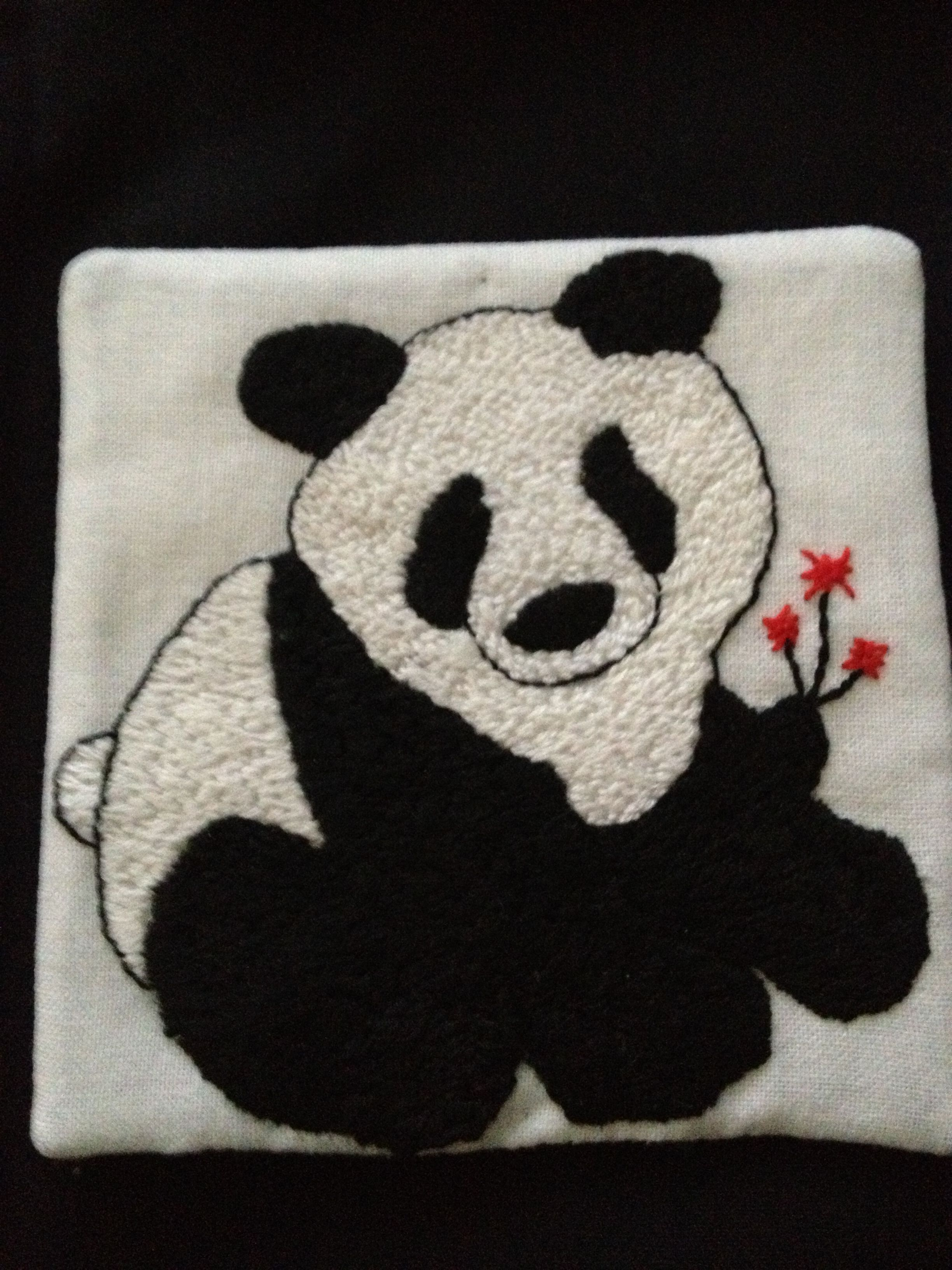 Lovely little panda worked in embroidery stitches