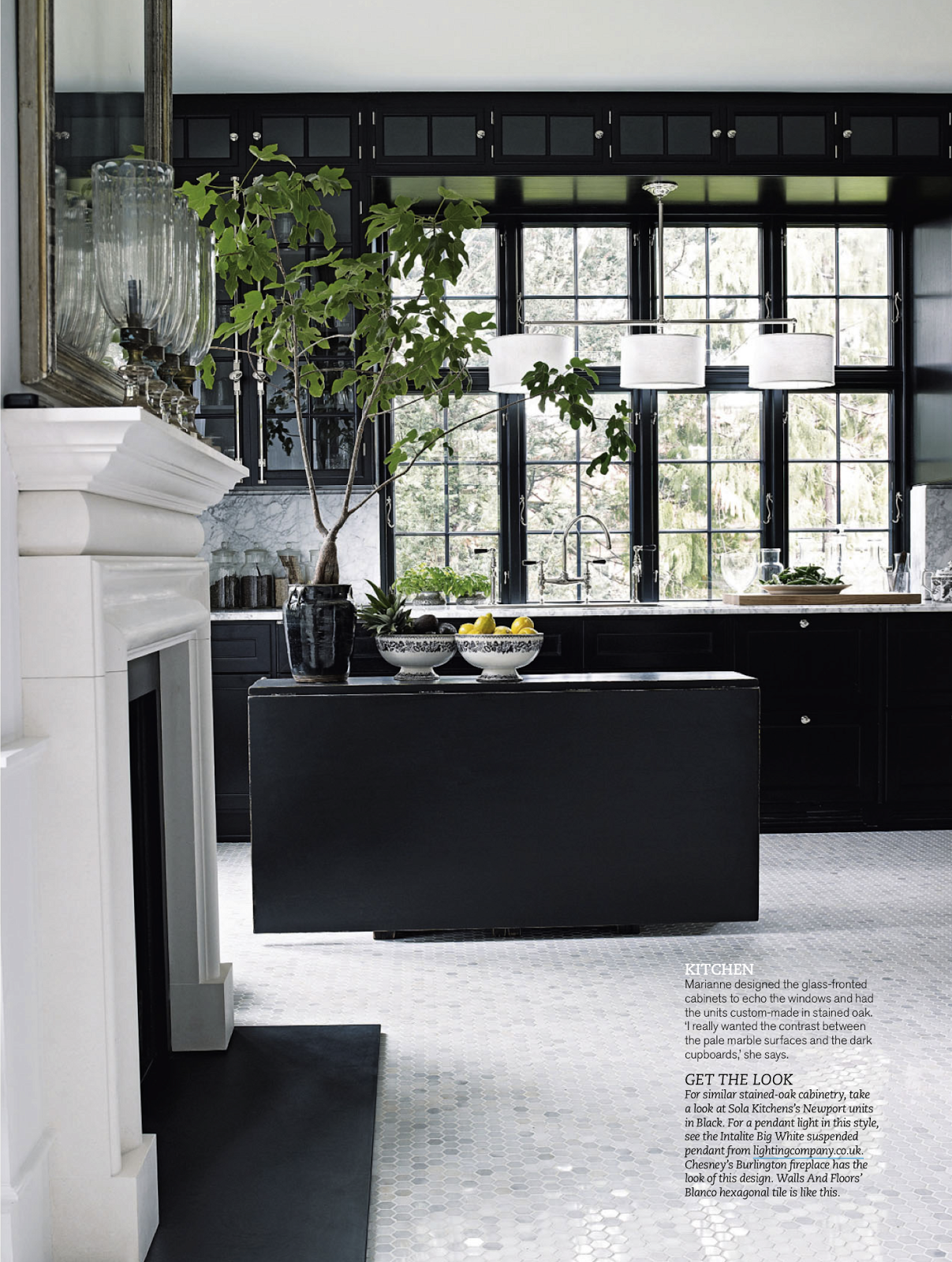 Black Kitchen with whiteTwelve Chairs Boston magazine