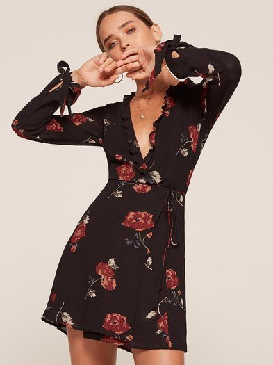 You probably need a new dress. This is a mini length, wrap dress with a ruffle edged bodice and adjustable sleeve ties.
