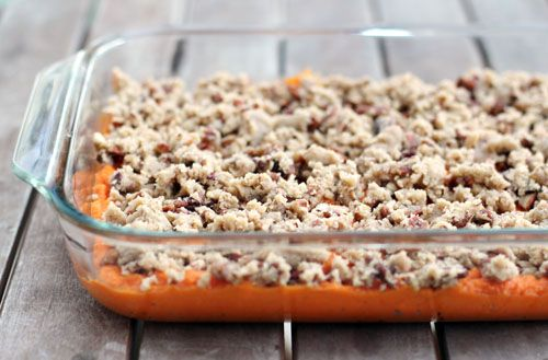 I don't have much to say about this recipe except that it's wonderful. I discovered sweet potato souffle last year when my friend Mindy made it for our Thanksgiving dinner. She got the recipe from her sister who got from a friend who got it from a friend and, well, you get the idea. It's one of