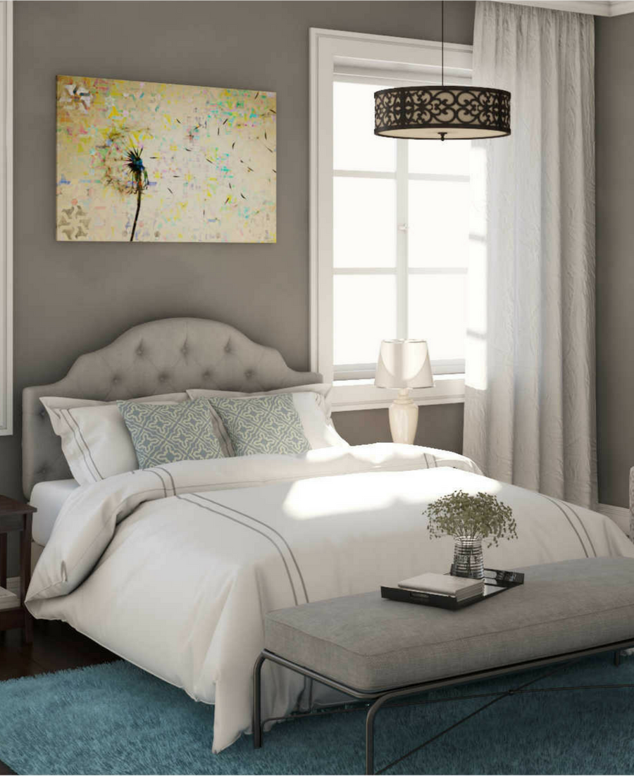 This bedroom has a great gray tufted
