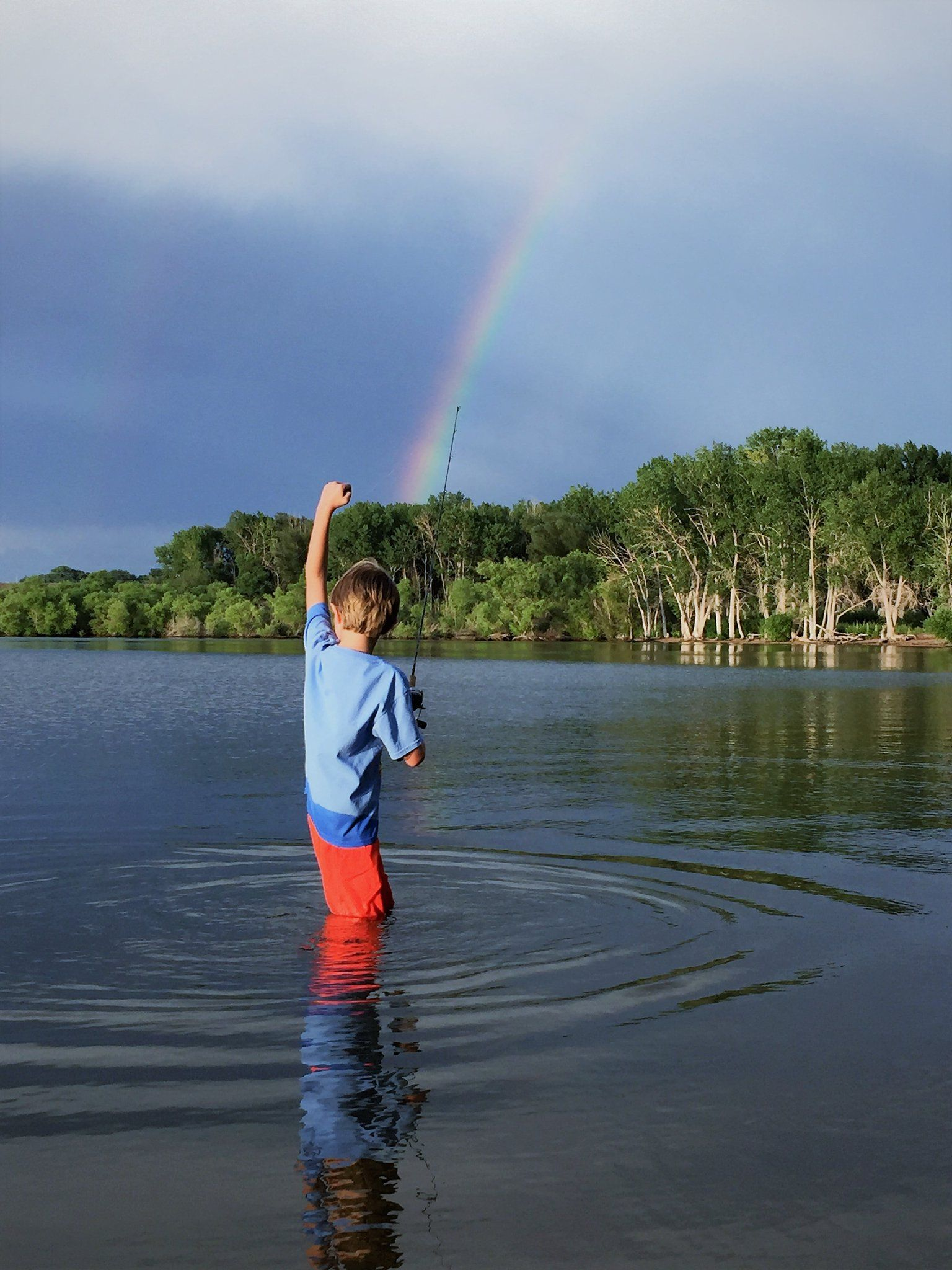 Went fishing under rainbows with my kid last night. I
