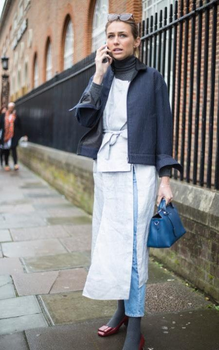 Take notes from this showgoer's take on layering - styling a dress over jeans and a poloneck adds extra pizazz to a basic look