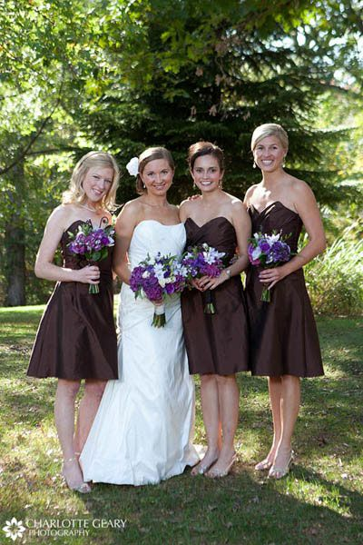Bridesmaids In Brown Strapless Dresses With Purple Flowersthis Is For Those Of