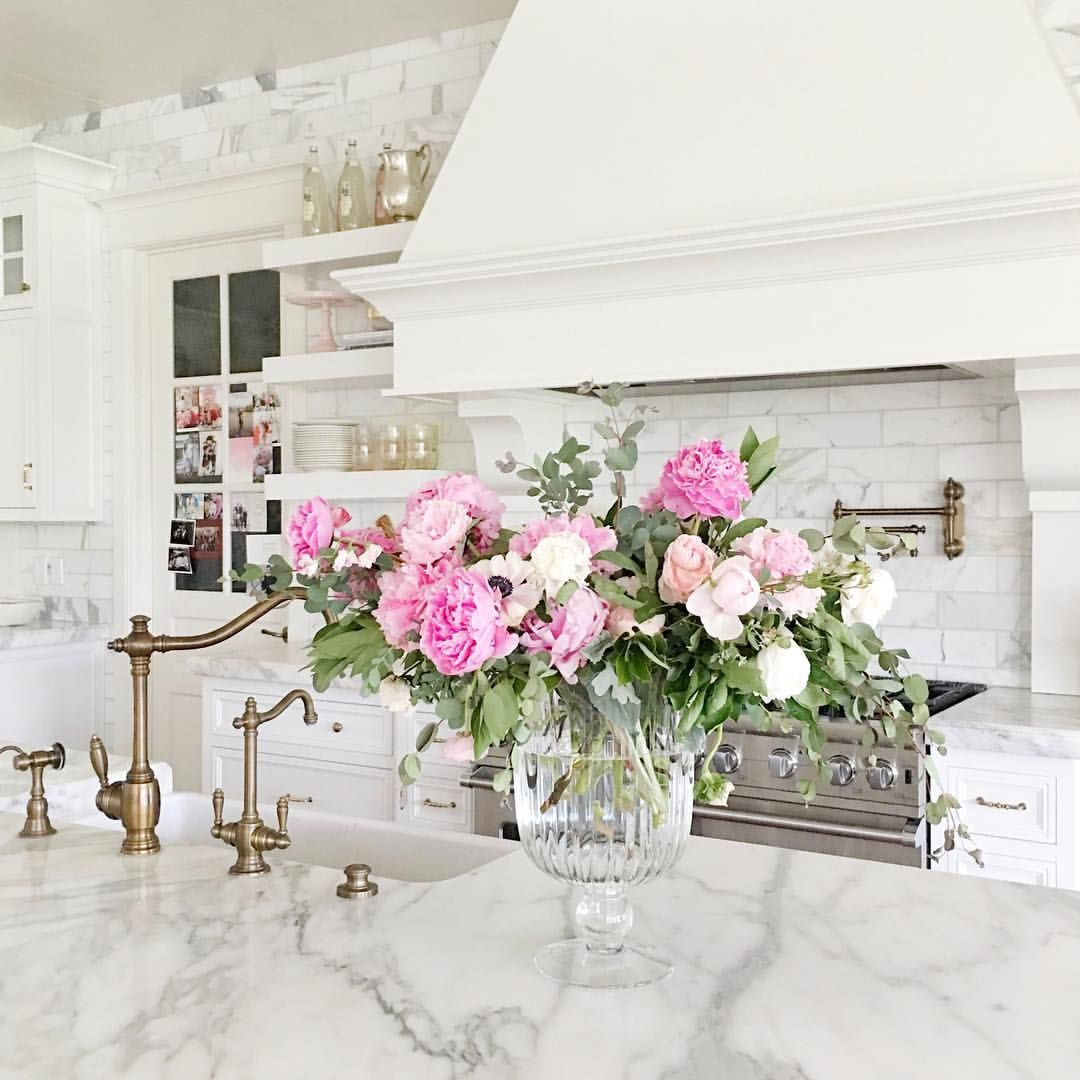 White Kitchen With Marble Countertops And Backsplash