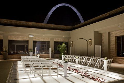 Wedding location, guests with drinks in hand already from the bar