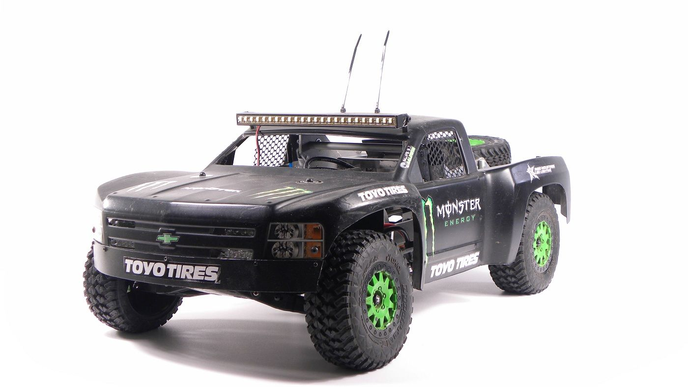This Is A Custom Made Rc Desert Trophy Truck Donor Chassies Was Traxxas Slash 2wd And It S Been Teared Down To Pieces So Trophy Truck Trucks Traxxas Slash 2wd