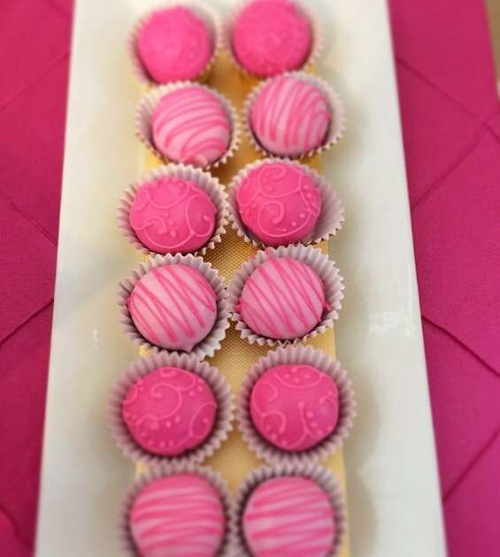 Fushia and gold birthday party truffles! See more party planning ideas at CatchMyParty.com!