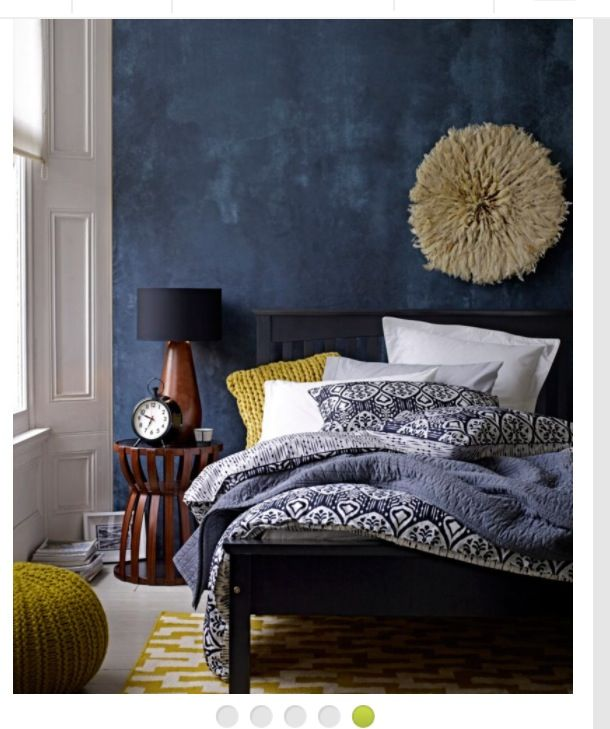 our new bedding love the dark blue wall blue and white blue rh pinterest com