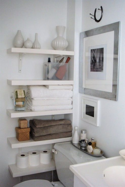 bathroom with lots of storage space white floating shelves rh pinterest com