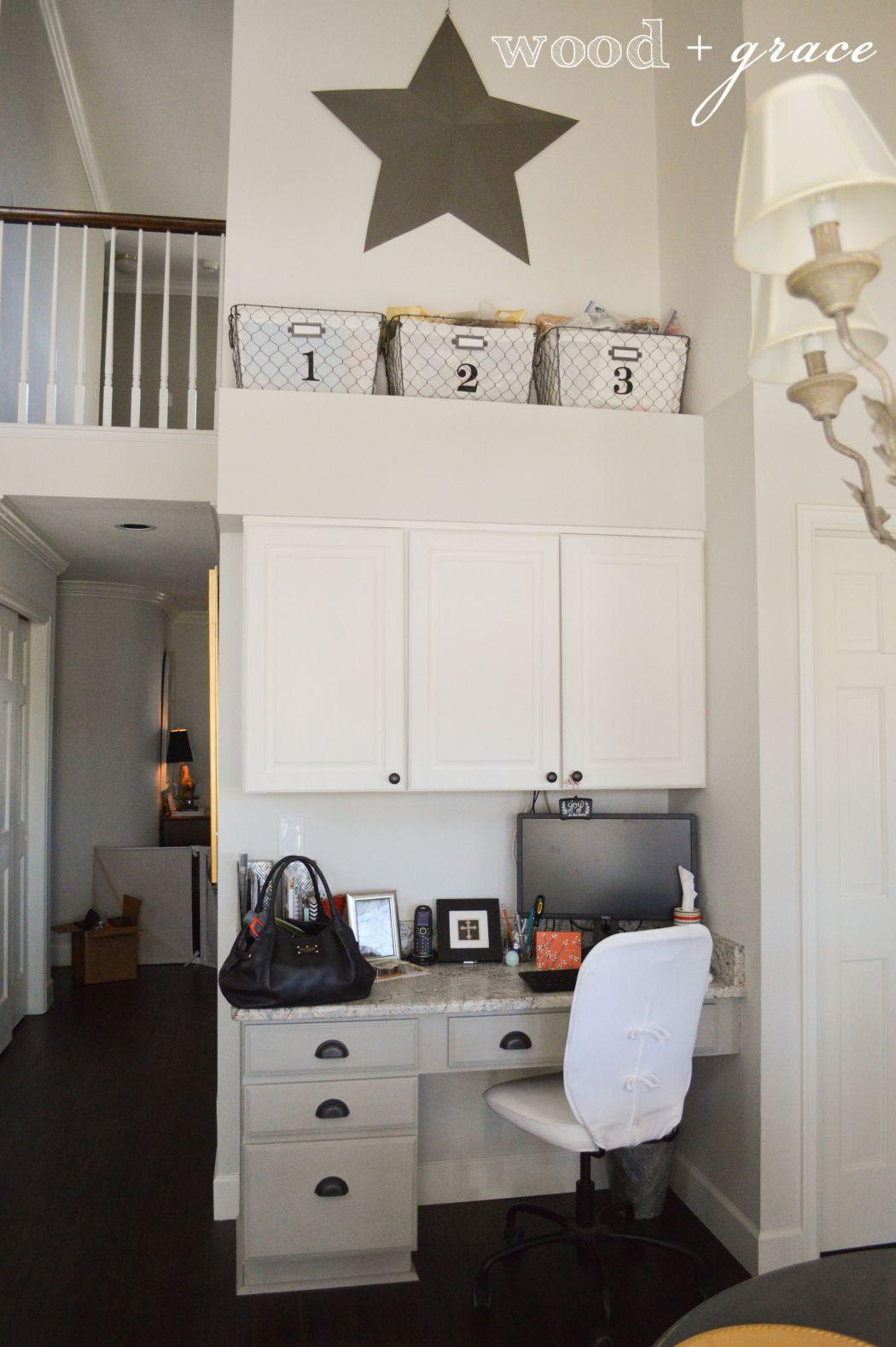 kitchen White refrigerator, Black dishwasher, Wood laminate