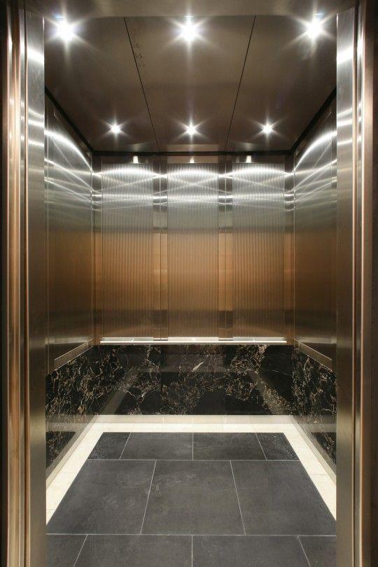 Elevator interior with black stone base | Elevator design ...