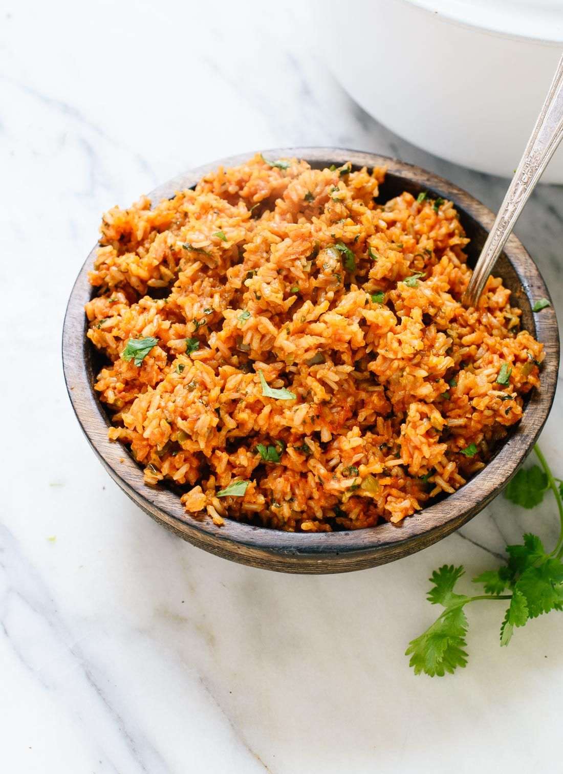 Amazing Mexican brown rice - tastes just like your favorite Mexican restaurant's rice, but made healthier! cookieandkate.com