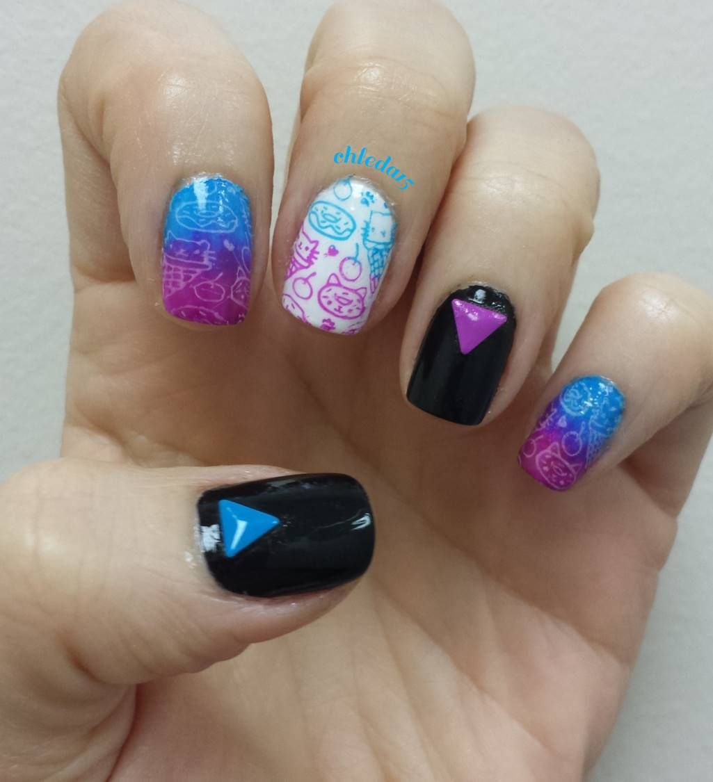 Nail Polish On Pinky Finger Meaning: Thumb And Ring Painted Solid Black With Triangle Color
