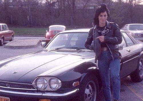 Joan Jett posing with her first car, a Jaguar XJ-S