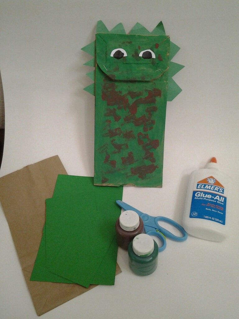 Dinosaur paper bag puppet.