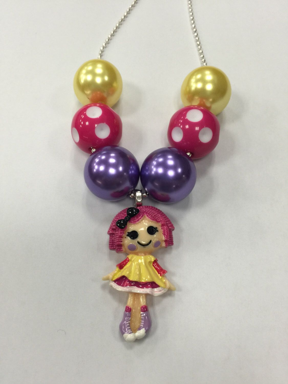 A personal favorite from my Etsy shop https://www.etsy.com/listing/236472589/lalaloopsy-chunky-necklace-bubblegum