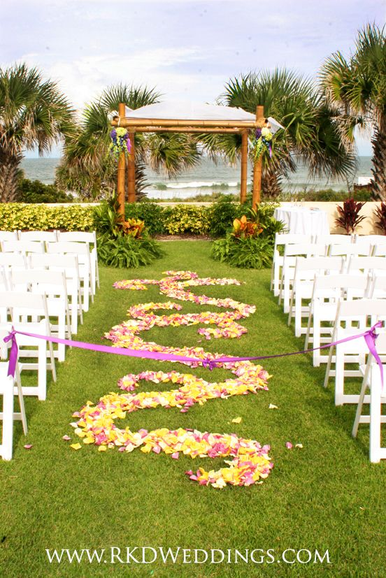 Wedding Ceremony Held At Hammock Beach Resort In Palm Coast Florida Beautiful Bamboo Arbor Adorned With Green And Purple Hydrangea Along