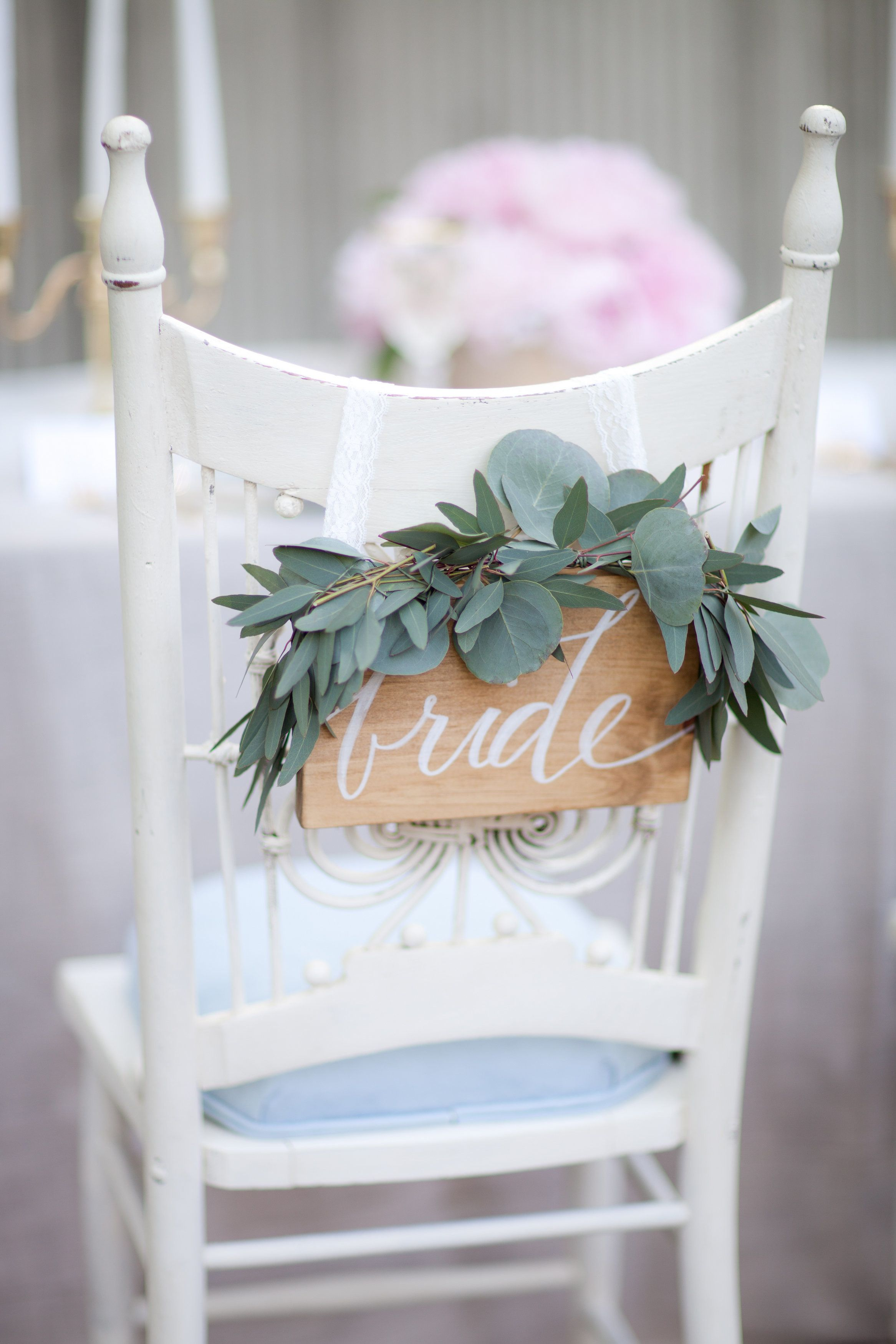 bride chair with greens and calligraphy