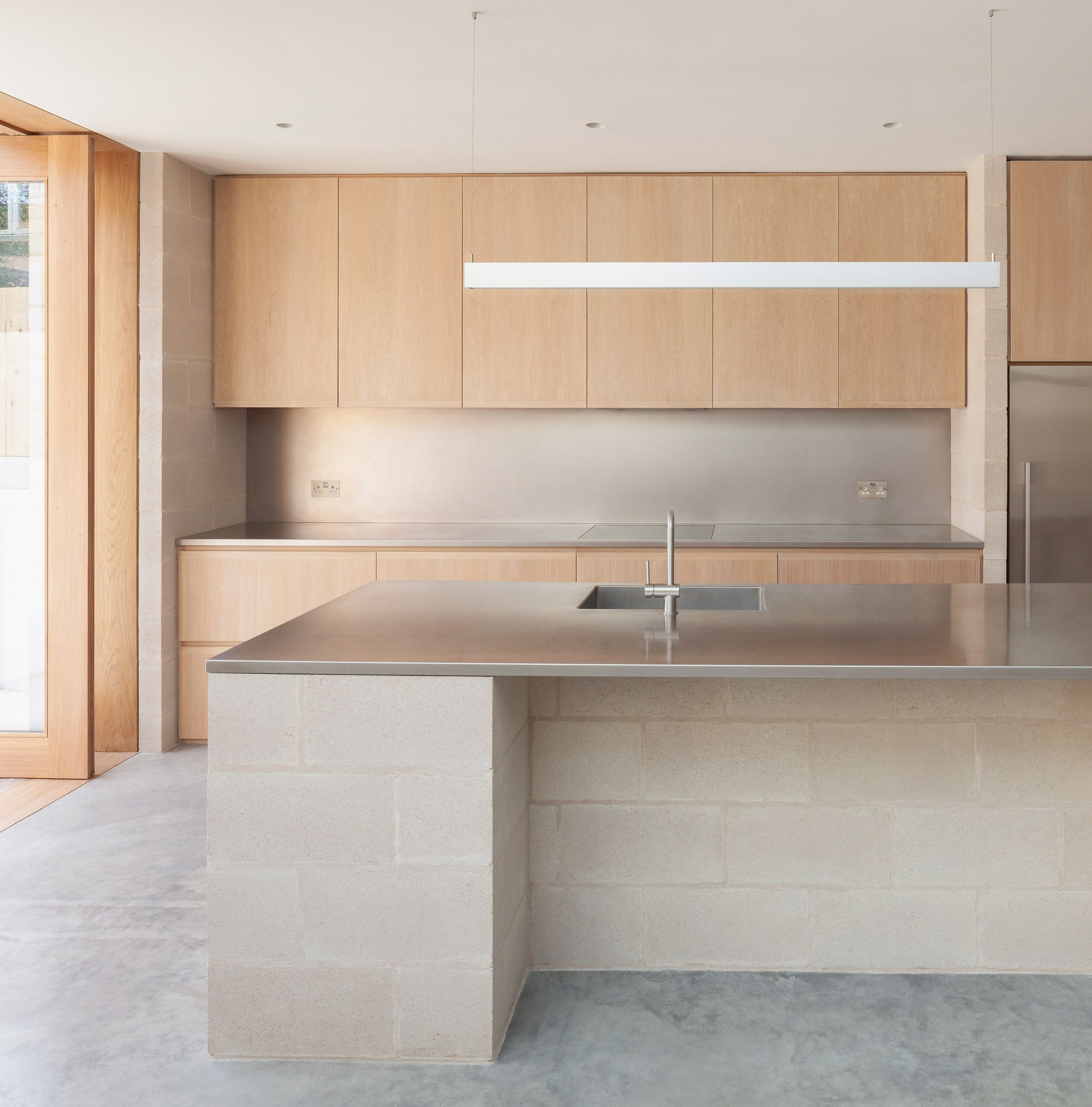 a polished concrete floor and stainless steel countertops were rh pinterest es