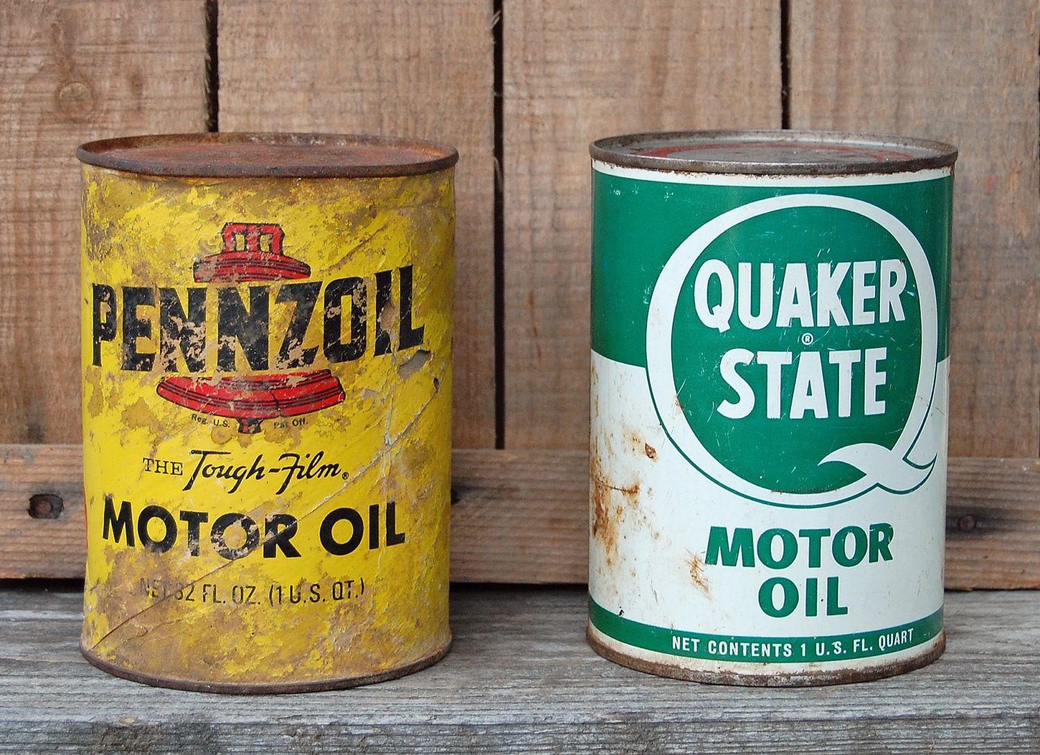 This Set Of Two Vintage Motor Oil Cans Includes A