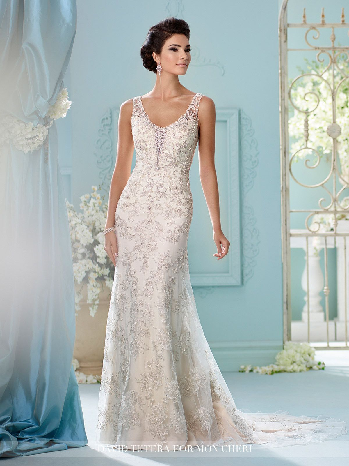 David Tutera - Sleeveless tulle over crepe soft satin and metallic hand-beaded embroidered lace fit and flare gown with beaded illusion shoulder straps, soft V-neckline trimmed with beading and illusi